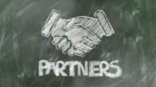 パートナーとして握手